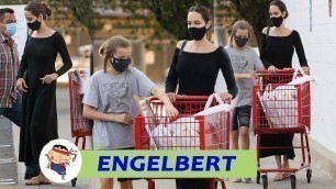 Angelina Jolie looks tired when appearing with her daughter Vivienne packing up school supplies ...